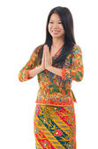 Southeast Asian woman greeting — Stock Photo