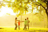 Happy Asian family playing — Stockfoto