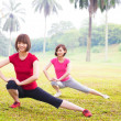 Royalty-Free Stock Photo: Two Asian girls stretching