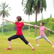 Asian girls yoga outdoor — Stock Photo