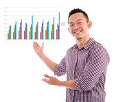 Asian showing business chart — Stock Photo