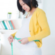 Asian woman measures her stomach — Stock Photo