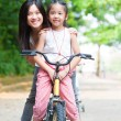 Stock Photo: Asifamily riding bike