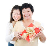 Asian family and gift box — Stock Photo