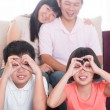 Southeast Asian family at home — Stock Photo