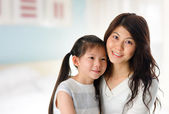 Young girl and mother at home. — Stock Photo
