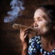 Old Asian woman smoking  — Stock Photo