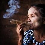 Old Asian woman smoking — Stock Photo #24367521
