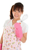 Asian girl holding egg beater — Stock Photo