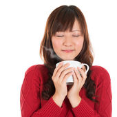 Asian girl enjoying coffee — Stock Photo