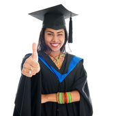 Indian graduate student giving thumb up hand sign — Stockfoto