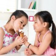 Asian girls eating ice cream — Stock Photo #26547051