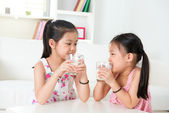 Children drinking milk. — Stock Photo