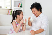 Drinking milk at home — Stock Photo
