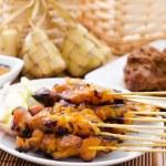 Chicken satay and ketupat — Stock Photo #26720443