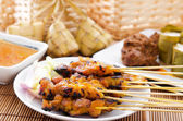 Chicken satay and ketupat — Stock Photo