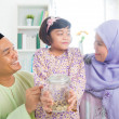 Southeast Asian Malay family saving money — Stock Photo