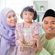 Malay family saving money  — Stock Photo