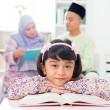 Muslim girl reading book. — Stock Photo