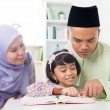 Malay Muslim parents teaching child — Stock Photo #27030505