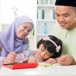 Muslim family drawing and painting — Stock Photo