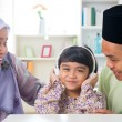 Stock Photo: Muslim girl listening to music