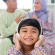 Muslim girl listening to song — Stock Photo