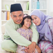 Stock Photo: Muslim parents hugging child