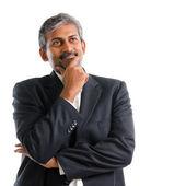 Indian businessman thinking. — Stock Photo