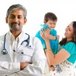 Indian medical doctor and patient family — Stock Photo