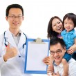 Chinese male medical doctor and young patient family — Stock Photo