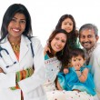 Foto Stock: Indian female medical doctor and patient family.