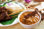Satay skewered and grilled meat — Stock Photo