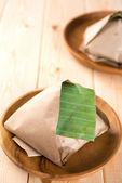 Nasi Lemak packed in banana leaf — Stock Photo