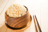 Cooked organic basmati brown rice with chopsticks — Stock Photo