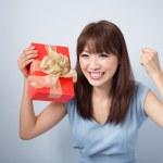 Happy Asian Girl Holding Gift Box — Stock Photo #29176305