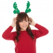 Asian Christmas woman wearing reindeer horns. — Stock Photo #29170615