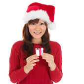 Santa hat Christmas woman holding Christmas gift — Stock Photo