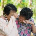 Sad senior Asian women — Stock Photo #29558331