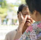 Consoling crying old mother — Stock Photo