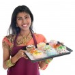 Traditional Indian woman baking cupcakes — Stock Photo