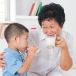 Family drinking milk — Stock Photo #29764619