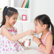 Children eating yoghurt  — Stock Photo