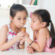 Asian kids eating ice cream cone — Stock Photo