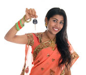 Indian woman holding car key — Stock Photo