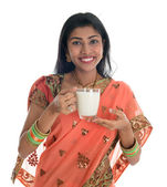 Indian woman in sari drinking milk — Stock Photo