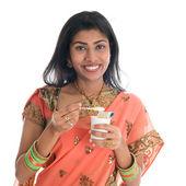 Traditional Indian woman eating yogurt — Stock Photo