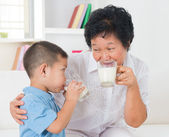 Family drinking milk — Stock Photo