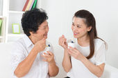 Asian women eating yogurt. — Stock Photo
