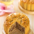 Assorted fruits nuts mooncakes with tea — Stock Photo